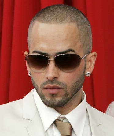The duo Wisin & Yandel, left, pose for photos as they arrive at the Latin Billboard Music Awards show in Hollywood, Fla. Thursday, April 10, 2008.  (AP Photo/Wilfredo Lee)