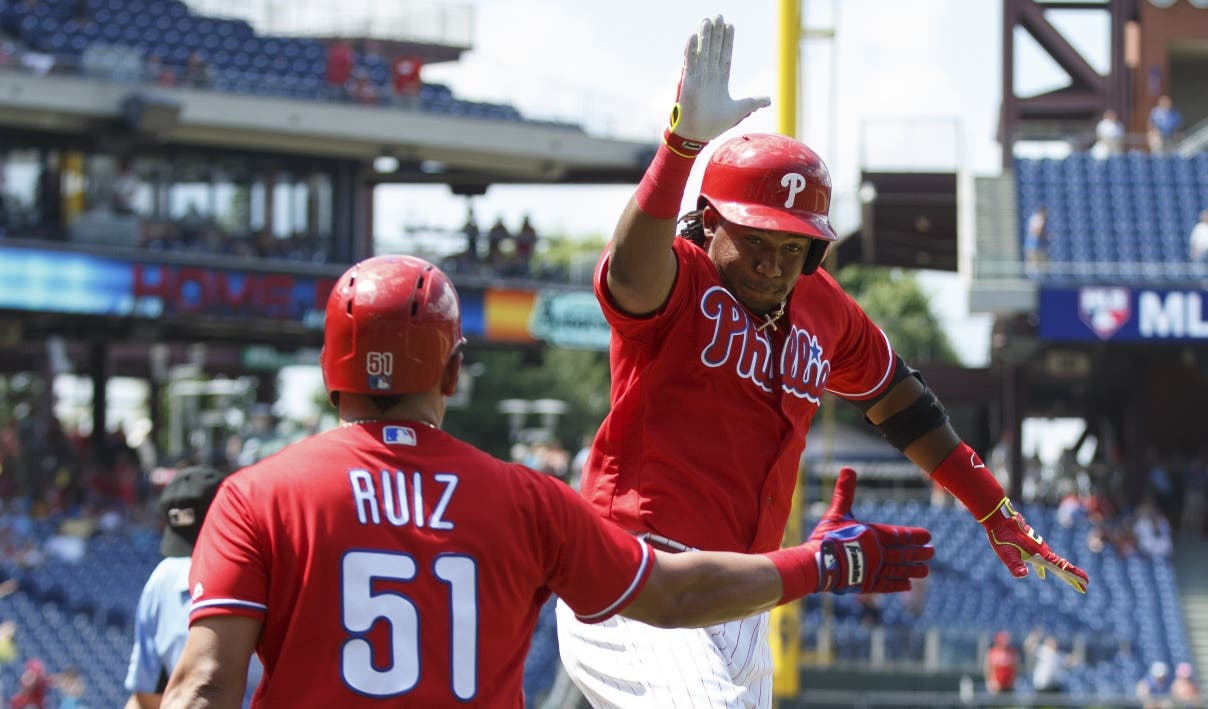 Philadelphia Phillies' Maikel Franco, right, celebrates his home run with Carlos Ruiz, left, during the sixth inning of a baseball game against the Atlanta Braves, Wednesday, July 6, 2016, in Philadelphia. The Phillies won 4-3. (AP Photo/Chris Szagola)