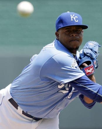 Kansas City Royals pitcher Edinson Volquez throws from the mound before a baseball game against the Texas Rangers at Kauffman Stadium in Kansas City, Mo., Sunday, June 24, 2016. (AP Photo/Colin E. Braley)