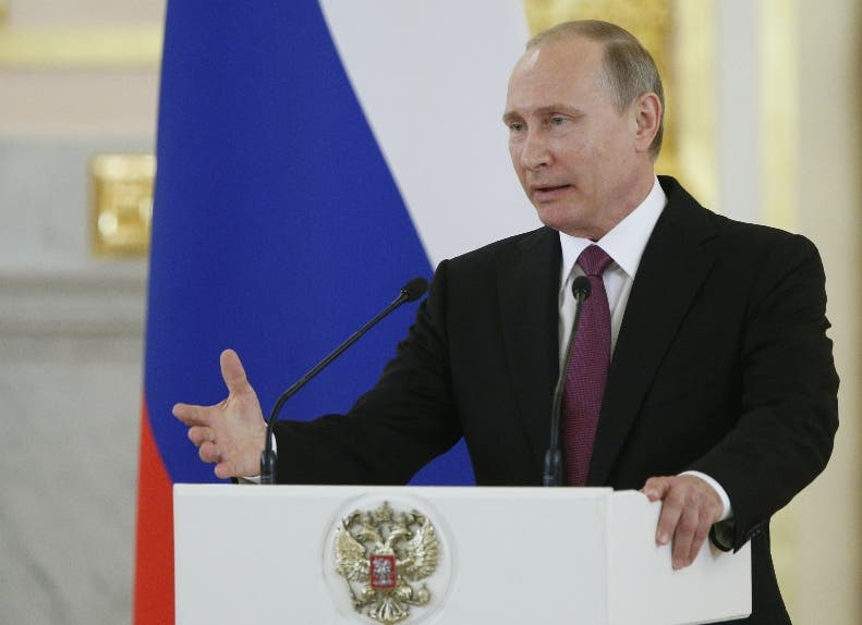 Russian President Vladimir Putin speaks at the Kremlin, in Moscow, Russia, Wednesday, July 27, 2016 during a reception for the Russia's Olympics team. At least 105 athletes from the 387-strong Russian Olympic team announced last week have been barred from the Rio Games in connection with the country's doping scandal. (AP Photo/Alexander Zemlianichenko)