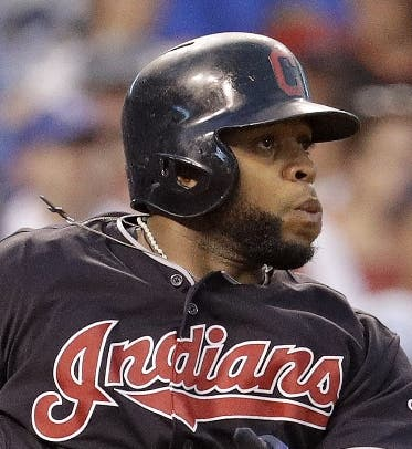 Cleveland Indians' Carlos Santana watches hit two run single during the fifth inning of a baseball game against the Kansas City Royals Tuesday, July 19, 2016, in Kansas City, Mo. (AP Photo/Charlie Riedel)
