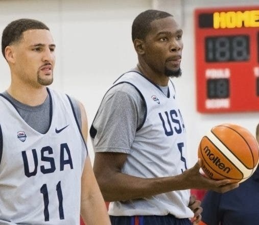Golden State Warriors teammates Klay Thompson, left, and Kevin Durant listen to coaches before Team USA basketball practice in Las Vegas on Monday, July 18, 2016. (Benjamin Hager/Las Vegas Review-Journal via AP)