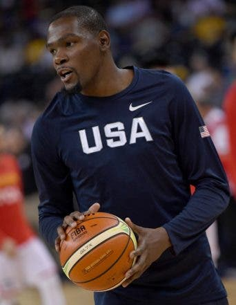 OAKLAND, CA - JULY 26: Kevin Durant #5 of the United States Men's National Team warms up prior to playing the China Men's National Team in a USA Basketball showcase exhibition game at ORACLE Arena on July 26, 2016 in Oakland, California.   Thearon W. Henderson/Getty Images/AFP == FOR NEWSPAPERS, INTERNET, TELCOS & TELEVISION USE ONLY ==