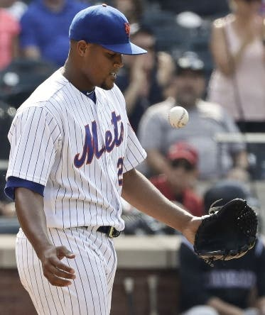 New York Mets relief pitcher Jeurys Familia reacts after a run scored on a wild pitch during the ninth inning of a baseball game against the Colorado Rockies Thursday, July 28, 2016, in New York. (AP Photo/Frank Franklin II)