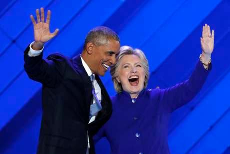 President Barack Obama and Democratic Presidential nominee Hillary Clinton wave to delegates after President Obama's speech during the third day of the Democratic National Convention in Philadelphia , Wednesday, July 27, 2016. (AP Photo/J. Scott Applewhite) Obama