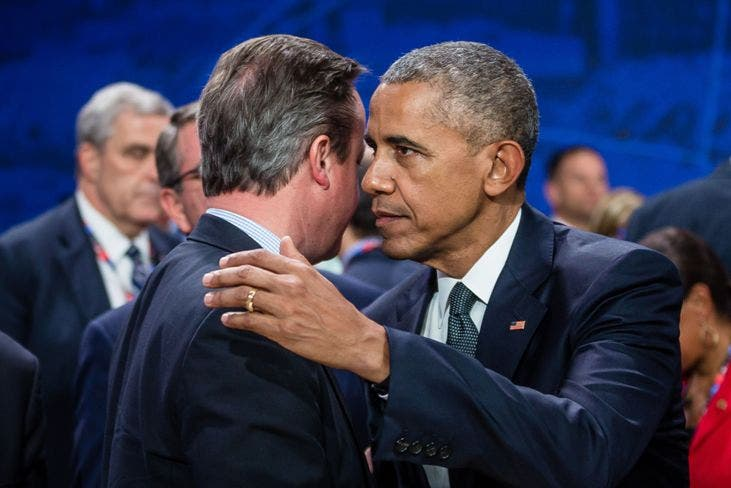 US President Barack Obama (R) and Great Britain's Prime Minister David Cameron (L) chat prior to the meeting of the heads of states of the North Atlantic Council (NAC), during the NATO summit in Warsaw, Poland. The Polish capital Warsaw hosts a two-day top-level NATO meeting, first time since Poland joined the alliance in 1999. / AFP / WOJTEK RADWANSKI