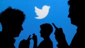 """People holding mobile phones are silhouetted against a backdrop projected with the Twitter logo in this illustration picture taken in  Warsaw September 27, 2013.   REUTERS/Kacper Pempel/Illustration/File Photo     GLOBAL BUSINESS WEEK AHEAD PACKAGE - SEARCH """"BUSINESS WEEK AHEAD JULY 25"""" FOR ALL IMAGES - RTSJGEW"""