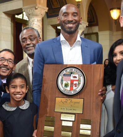 "Former Los Angeles Lakers basketball player Kobe Bryant holds a commemorative plaque as he poses with, from left, Los Angeles City Attorney Mike Feuer; council members Jose Huizar, Herb Wesson Jr. and Curren Price Jr.; his daughter Gianna; wife, Vanessa, partly obscured; and Mayor Eric Garcetti during Kobe Bryant Day events at Los Angeles City Hall on Wednesday, Aug. 24, 2016. Bryant called the experience ""surreal"" and jokingly said someone would have to explain to his unborn daughter why ""daddy has a day named for him."" Bryant played his entire 20-season career with the Lakers, leading them to five NBA championships. (Walt Mancini/The Pasadena Star-News/Southern California Newspaper Group via AP)"