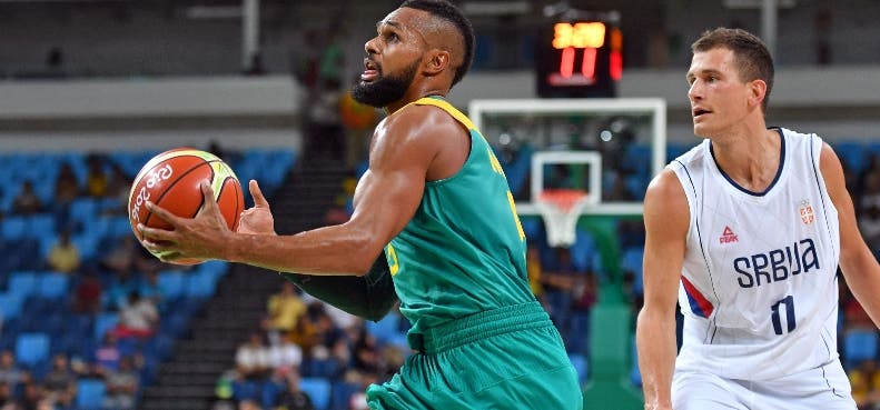 Australia's guard Patty Mills (L) evades Serbia's guard Nemanja Nedovic during a Men's round Group A basketball match between Serbia and Australia at the Carioca Arena 1 in Rio de Janeiro on August 8, 2016 during the Rio 2016 Olympic Games. / AFP / Andrej ISAKOVIC