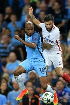 Manchester City's Fabian Delph, left, and Steaua Bucharest's Gabriel Enache battle for the ball during their Champions League Play-off, Second Leg match at the Etihad Stadium, Manchester, England, Wednesday Aug. 24, 2016. (Nigel French / PA via AP)