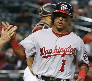 Washington Nationals' Wilmer Difo (1) celebrates his run scored against the Arizona Diamondbacks with Danny Espinosa, left, during the ninth inning of a baseball game Wednesday, Aug. 3, 2016, in Phoenix. The Nationals defeated the Diamondbacks 8-3. (AP Photo/Ross D. Franklin)