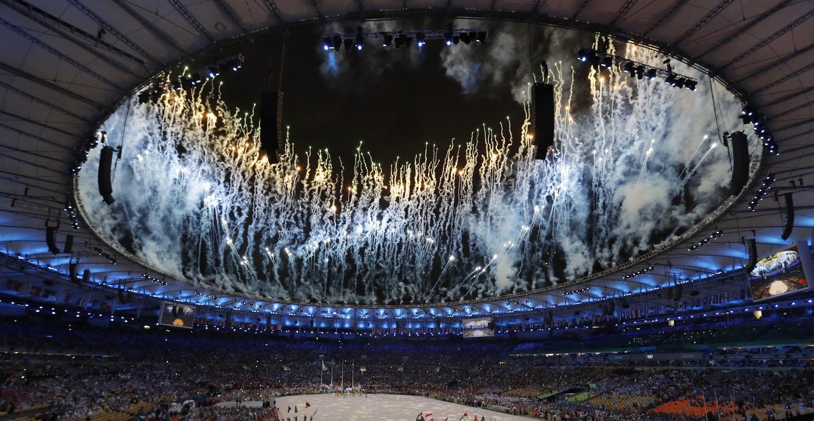 Fireworks explode during the closing ceremony for the Summer Olympics at Maracana stadium in Rio de Janeiro, Brazil, Sunday, Aug. 21, 2016. (AP Photo/Vincent Thian)