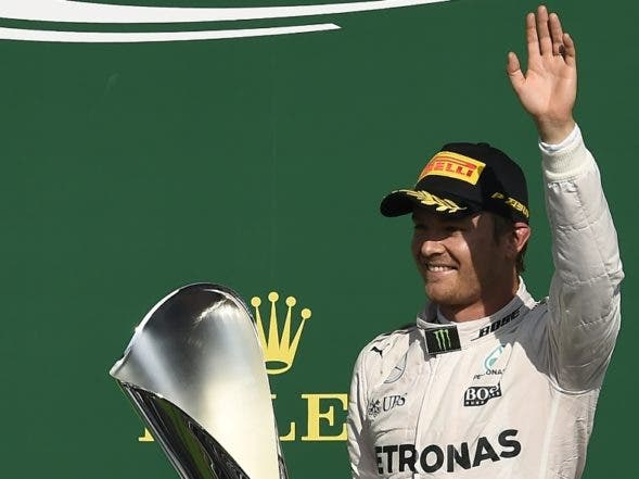 Mercedes AMG Petronas F1 Team's German driver Nico Rosberg celebrates winning on the podium after the Belgian Formula One Grand Prix at the Spa-Francorchamps circuit in Spa on August 28, 2016.  / AFP / JOHN THYS