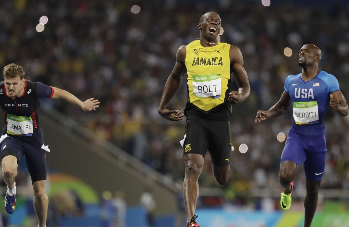 Usain Bolt from Jamaica, center, celebrates after crossing the line to win the gold medal in the men's 200-meter final during the athletics competitions of the 2016 Summer Olympics at the Olympic stadium in Rio de Janeiro, Brazil, Thursday, Aug. 18, 2016. (AP Photo/David J. Phillip)