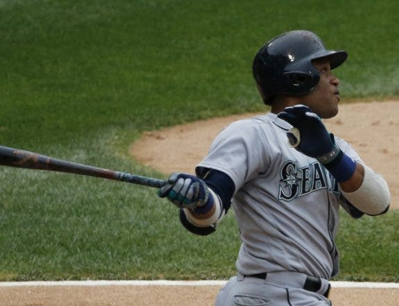 Seattle Mariners' Robinson Cano hits a solo home run against the Chicago White Sox during the sixth inning of a baseball game in Chicago, Sunday, Aug. 28, 2016. (AP Photo/Nam Y. Huh)
