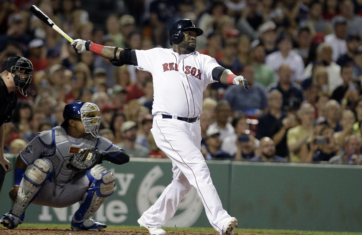 Boston Red Sox's David Ortiz, right, hits a home run as Kansas City Royals' Salvador Perez, left, looks on in the fourth inning of a baseball game, Sunday, Aug. 28, 2016, in Boston. (AP Photo/Steven Senne)