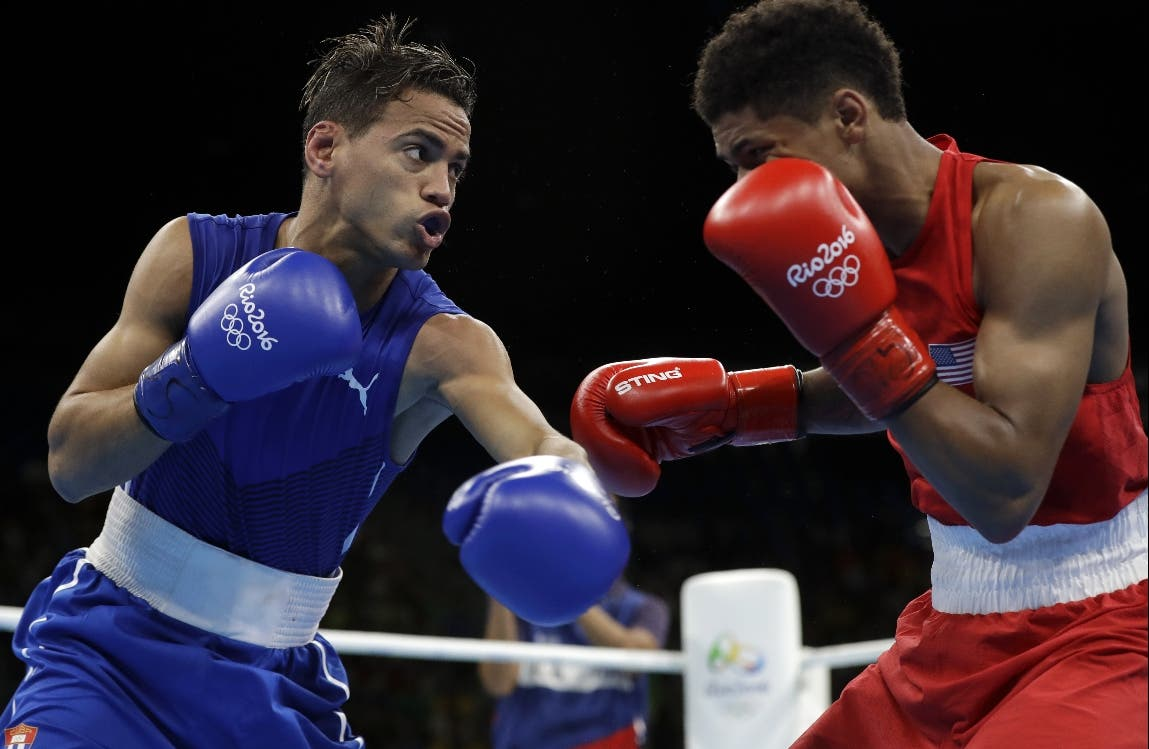 Cuba's Robeisy Ramirez, left, fights United States' Shakur Stevenson during a men's bantamweight 56-kg final boxing match at the 2016 Summer Olympics in Rio de Janeiro, Brazil, Saturday, Aug. 20, 2016. (AP Photo/Frank Franklin II)