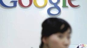 A South Korean woman walks past the Google logo at the company's local Seoul office on May 3, 2011. South Korean police raided Google's local office to investigate whether the global search company used its mobile phone advertising platform to illegally collect private location data.  REPUBLIC OF KOREA OUT  NO ARCHIVES  NO INTERNET     AFP PHOTO/YONHAP