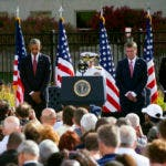 President Barack Obama, left, Secretary of Defense Ashton Carter, second from right, and Chairman of the Joint Chiefs Marine Corps Gen. Joseph Dunford, right, bow their heads as a prayer is said at a Sept. 11 memorial observance ceremony at the Pentagon, Sunday, Sept. 11, 2016. (AP Photo/Cliff Owen)