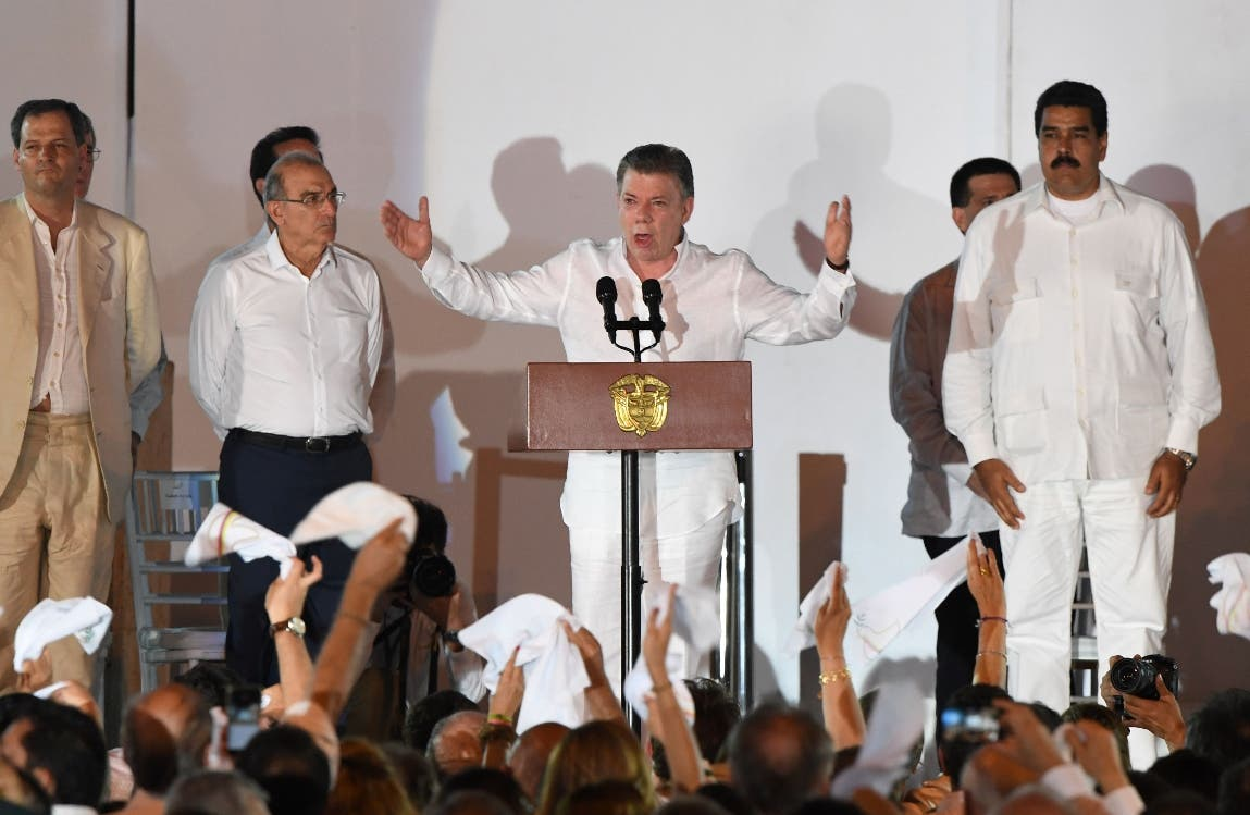 "Colombian President Juan Manuel Santos delivers a speech after signing the historic peace agreement between the Colombian government and the Revolutionary Armed Forces of Colombia (FARC), in Cartagena, Colombia, on September 26, 2016  The Colombian government and the leftist FARC rebel force signed a historic peace accord to end a half-century conflict that has killed hundreds of thousands of people. Santos and ""Timochenko"" Jimenez, signed the deal at a ceremony in the Caribbean city of Cartagena, prompting loud cheers from the crowd which included numerous international dignitaries.  / AFP / Luis ACOSTA"
