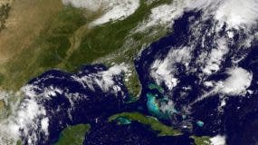 This NOAA-NASA GOES East satellite photo taken 1725 UTC, shows storm activity in the Atlantic Ocean on September 28, 2016. Tropical Storm Matthew formed in the Atlantic over the Lesser Antilles on Wednesday and threatened to become a hurricane by Friday, US forecasters said. Tropical storm warnings were issued for Guadeloupe and Martinique, as well as Barbados, Dominica, St Vincent, Grenada and St Lucia.The tropical storm was located about 55 kilometers (35 miles) southeast of St Lucia, and was moving westward with maximum sustained winds of 95 kilometers (60 miles) per hour, the Miami-based National Hurricane Center said.  / AFP / NOAA-NASA GOES Project / HO