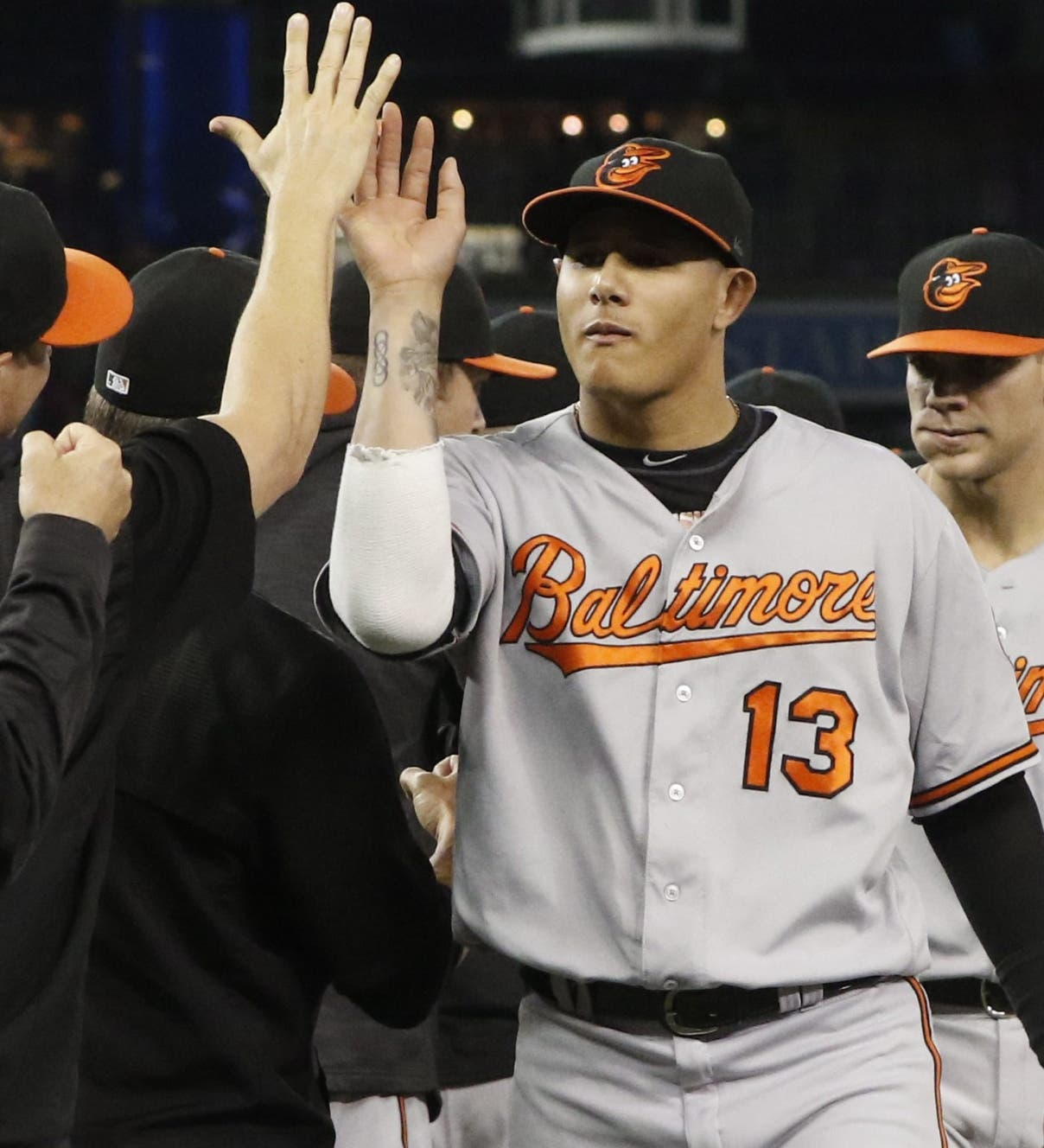 Baltimore Orioles' Manny Machado (13) and Chris Davis (19) celebrate after defeating the Toronto Blue Jays in a baseball game in Toronto, Thursday Sept. 29, 2016. (Mark Blinch/The Canadian Press via AP)