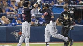 Cleveland Indians' Carlos Santana, right, celebrates with teammate Jason Kipnis after hitting a solo home run against the Toronto Blue Jays during the third inning in Game 5 of baseball's American League Championship Series in Toronto, Wednesday, Oct. 19, 2016.  (Mark Blinch/The Canadian Press via AP)