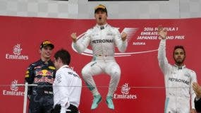 In this Sunday, Oct. 9, 2016 photo, Mercedes driver Nico Rosberg, center, of Germany celebrates on the podium after winning the Japanese Formula One Grand Prix at the Suzuka International Circuit in Suzuka, Japan. Red Bull driver Max Verstappen of the Netherlands was second and Mercedes driver Lewis Hamilton, right, of Britain third. (AP Photo/Toru Takahashi, File)