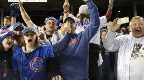 Chicago Cubs fans cheer after Game 6 of the National League baseball championship series against the Los Angeles Dodgers, Saturday, Oct. 22, 2016, in Chicago. The Cubs won 5-0 to win the series and advance to the World Series against the Cleveland Indians. (AP Photo/Nam Y. Huh)