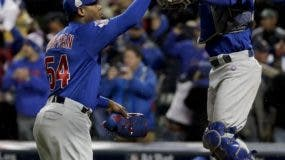 Chicago Cubs relief pitcher Aroldis Chapman, left, and catcher Willson Contreras celebrates their win against the Cleveland Indians after Game 2 of the Major League Baseball World Series Wednesday, Oct. 26, 2016, in Cleveland. The Cubs won 5-1 to tie the series 1-1. (AP Photo/Matt Slocum)