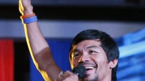 FILE - In this April 28, 2016, file photo, boxing star Manny Pacquiao addresses supporters as he campaigns for a seat in the Philippine Senate in San Pablo city, Laguna province, Philippines. Pacquiao was concentrating on trying to get the death penalty restored in the Philippines. Now he's focusing on something not nearly as controversial _ his return to the ring for a Nov. 5 fight with Jesse Vargas. (AP Photo/Bullit Marquez, File)
