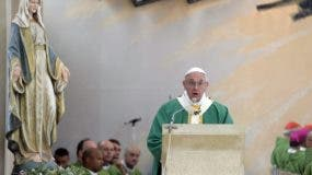 Pope Francis celebrates a Mass at Baku's Church of the Immaculate, Azerbaijan, Sunday, Oct. 2, 2016. Francis arrived in Azerbaijan on Sunday for a 10-hour visit aimed at encouraging the country's inter-religious harmony while likely overlooking recent criticism of a referendum that extends the president's term and powers. (L'Osservatore Romano/Pool Photo via AP)