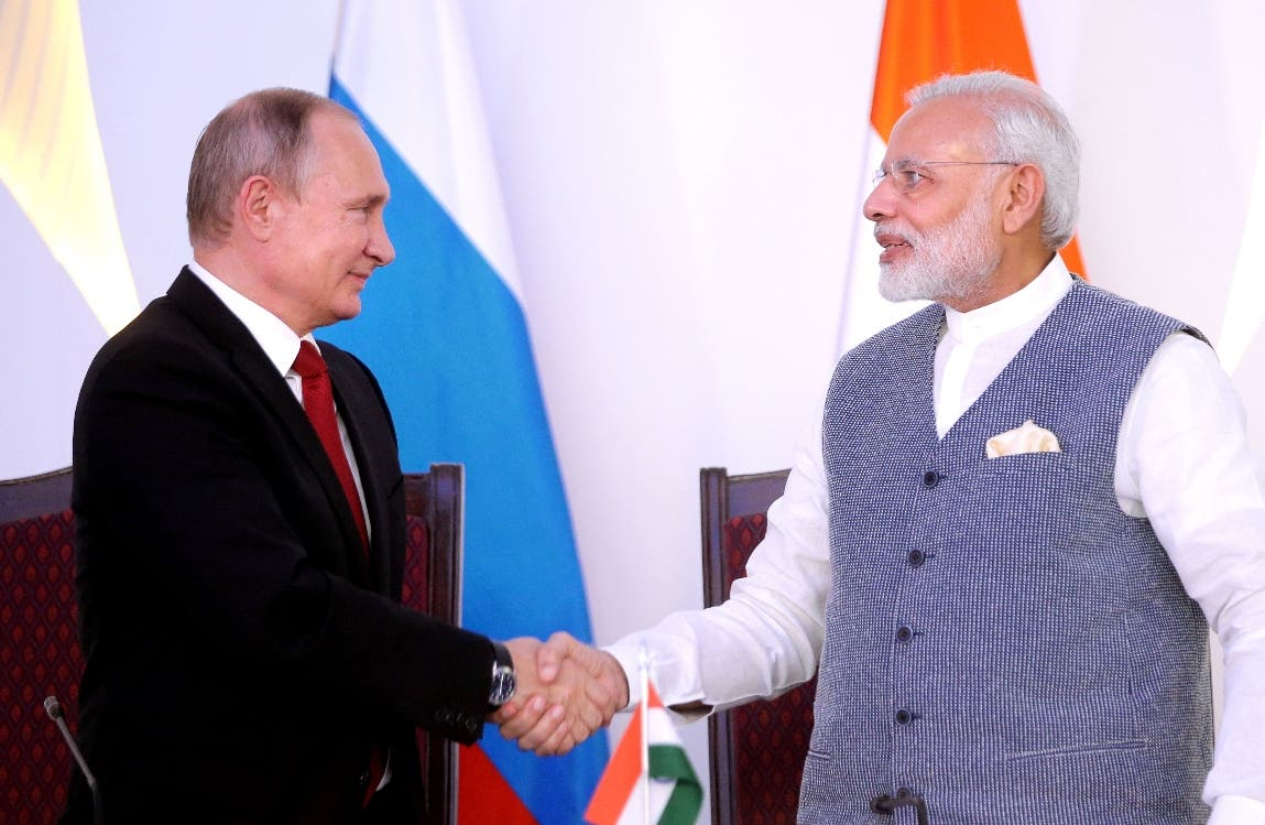 India Prime Minister Narendra Modi (R) shakes hands with Russian President Vladimir Putin during the exchange of agreements and joint press statements ceremony at Taj Exotica hotel in Goa on October 15, 2016. Indian Prime Minister Narendra Modi and Russian President Vladimir Putin signed lucrative defence and energy pacts on October 15 following talks aimed at reinvigorating ties between the former Cold-War allies. Goa is hosting the 8th annual BRICS summit (Brazil, Russia, India, China and South Africa) on October 15 and 16, 2016.  / AFP / SPUTNIK / Mihail Metzel