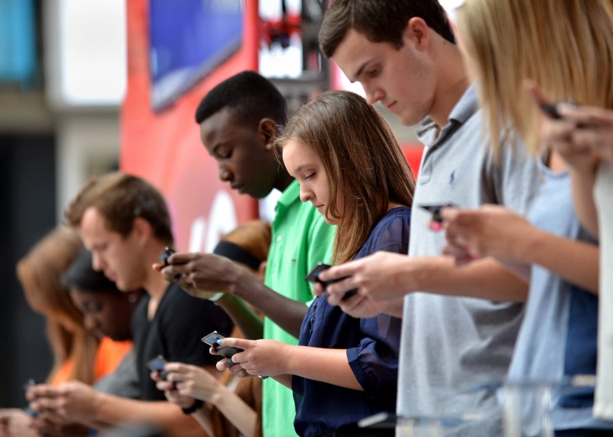 "Contestants compete in an early round during the 6th Annual LG US National Texting Championship August 8, 2012 in New York's Times Square. A 16-year-old boy retained his title as America's fastest texter Wednesday in a duel of the thumbs staged before yelling fans on New York's Times Square. Austin Weirschke took home $50,000 prize money for the second time in two years when he bested 10 other texting demons in feats of thumb speed, memory and fluency in texting shorthand. One round was performed with the remaining contestants blindfolded and having 45 seconds to type the verse: ""Twinkle, twinkle, little star, how I wonder what you are, up above the world so high, like a diamond in the sky."" The event, sponsored by LG Electronics and using the company's cell phones, took place on a traffic island in Times Square.  AFP PHOTO/Stan HONDA        (Photo credit should read STAN HONDA/AFP/GettyImages)"