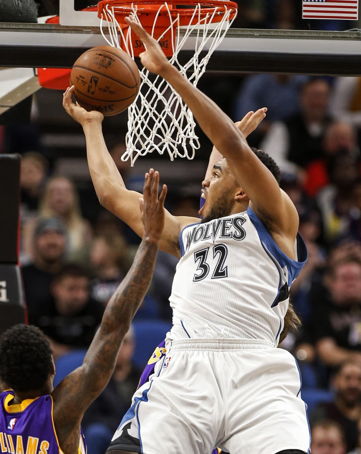 Minnesota Timberwolves center Karl-Anthony Towns (32) shoots against the Los Angeles Lakers in the second half of an NBA basketball game Sunday, Nov. 13, 2016, in Minneapolis. The Timberwolves won 125-99. (AP Photo/Bruce Kluckhohn)