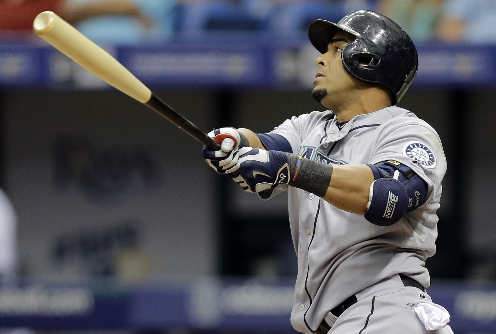Seattle Mariners' Nelson Cruz follows the flight of his three-run home run off Tampa Bay Rays relief pitcher Brad Boxberger during the ninth inning of a baseball game Wednesday, May 27, 2015, in St. Petersburg, Fla.  Mariners' Chris Taylor, and Robinson Cano also scored on the hit.  The Mariners won the game 3-0. (AP Photo/Chris O'Meara)