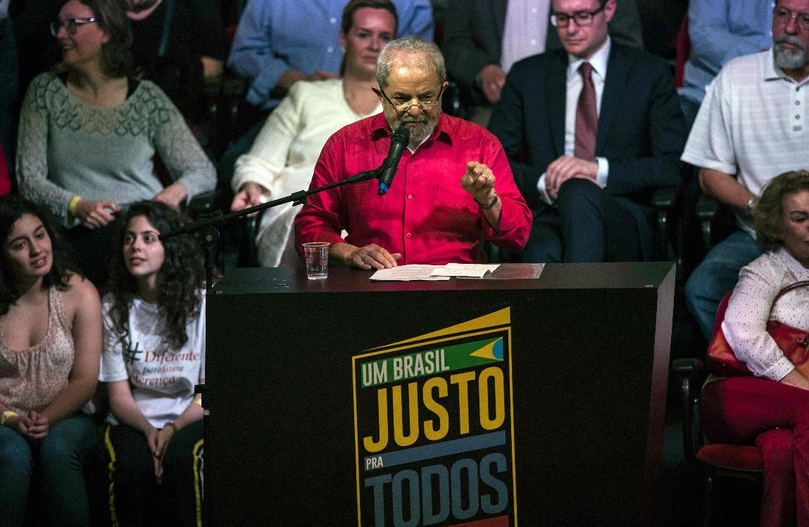 """Brazilian former president Luiz Inacio Lula da Silva delivers a speech during a meeting to launch the Campaign """"A fair Brazil for all and for Lula"""" organized by social movements, trade unions and political parties in Sao Paulo, Brazil on November 10, 2016.  The objective of the campaign is to initiate a broad movement throughout Brazil, as well as abroad, with events and demonstrations against the persecution of former President Lula da Silva and in defence of democracy. / AFP / NELSON ALMEIDA"""