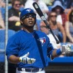 Toronto Blue Jays DH Edwin Encarnacion tosses his bat after a strike against the Pittsburgh Pirates during third inning Grapefruit League baseball action in Dunedin, Fla., on Tuesday, March 3, 2015. THE CANADIAN PRESS/Nathan Denette