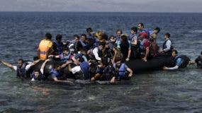 Syrian refugees arrive on the shores of the Greek island of Lesbos after crossing the Aegean Sea from Turkey on a inflatable dinghy on September 11, 2015. The EU unveiled plans to take 160,000 refugees from overstretched border states, as the United States said it would accept more Syrians to ease the pressure from the worst migration crisis since World War II. AFP PHOTO / ANGELOS TZORTZINIS        (Photo credit should read ANGELOS TZORTZINIS/AFP/Getty Images)