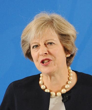 """British Prime Minister Theresa May delivers a speech at the British Academy in London on September 9, 2016. British Prime Minister Theresa May set out bold plans on Friday for more selection in schools, raising a deeply divisive issue two months into a premiership that has so far been defined by Brexit. The Conservative leader announced the end of a two-decade ban on new grammar schools, which only accept the brightest pupils, as part of a package of reforms intended to build a """"truly meritocratic Britain"""".  / AFP / POOL / Nick Ansell"""