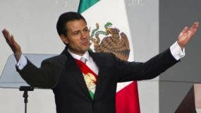Newly-sworn in Mexican President Enrique Pena Nieto gestures after delivering his first speech as head of state at the National Palace in Mexico City on December 1, 2012. Enrique Pena Nieto was sworn in as president of Mexico on Saturday following protests by leftist lawmakers inside the congress and clashes between demonstrators and police outside. AFP PHOTO/ Omar Torres