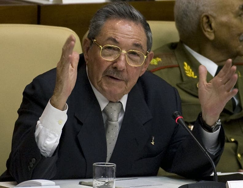 Cuba´s new president Raul Castro reacts after being elected to succeed his brother Fidel Castro by the Cuban national assembly, on February 24, 2008. Raul Castro succeeded his brother Fidel Castro as the president of Cuba Sunday in a historic power shift expected to keep Havana firmly on its communist path, officials said. The announcement was made to the national assembly by newly reelected speaker Ricardo Alarcon. AFP PHOTO/Luis ACOSTA