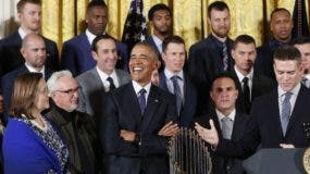 President Barack Obama listens as Cubs president Theo Epstein, right, speaks during a ceremony in the East Room of the White House in Washington, Monday, Jan. 16, 2017, where the president honored the 2016 World Series Champion baseball team. Also on stage are Cubs co-owner Laura Ricketts, second from left and manager Joe Maddon, third from left. (AP Photo/Pablo Martinez Monsivais)