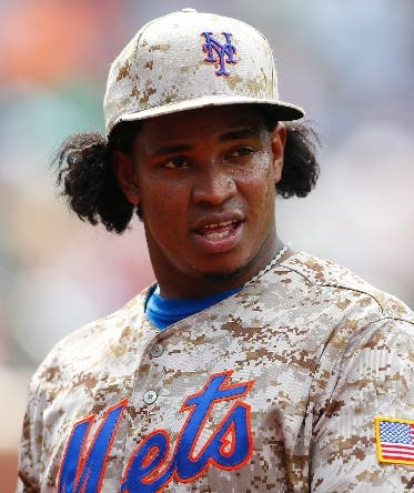 NEW YORK, NY - AUGUST 04: Jenrry Mejia #58 of the New York Mets in action against the San Francisco Giants at Citi Field on August 4, 2014 in the Flushing neighborhood of the Queens borough of New York City. Giants defeated the Mets 4-3.  (Photo by Mike Stobe/Getty Images)