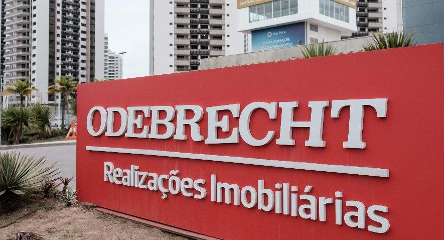 (FILES) This file photo taken on June 23, 2016 shows a logo of Brazilian construction company Odebrecht at the Olympic and Paralympic Village in Rio de Janeiro, Brazil. Brazil-based construction giant Odebrecht on December 21, 2016 agreed to pay fines of at least $2.6 billion to US, Brazilian and Swiss authorities, in what the US is calling the largest foreign bribery case in history. The US Justice Department said the conglomerate pled guilty to paying hundreds of millions to bribe government officials in countries on three continents.  / AFP / YASUYOSHI CHIBA