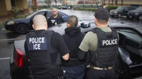 """This image obtained February 11, 2017 courtesy of the Immigration and Customs Enforcement (ICE) shows US Immigration and Customs Enforcement officers detaining a suspect during an enforcement operation on February 7, 2017 in Los Angeles, California.   US authorities arrested hundreds of undocumented migrants this week in the first large-scale raids under President Donald Trump, triggering panic in immigrant communities nationwide. The federal Immigration and Customs Enforcement agency rounded up undocumented individuals living in Atlanta, Austin, Chicago, Los Angeles, New York and other cities two weeks after Trump signed an executive order that broadened which undocumented immigrants would be targeted for deportation. According to ICE, however, the operations were """"routine.""""  / AFP / ICE / Charles Reed"""