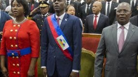Haiti's newly sworn-in President Jovenel Moise, second from left, stands with his wife Martine, left, former interim President Jocelerme Privert, second from right, and his wife Ginette, during his inauguration at Parliament in Port-au-Prince, Haiti, Tuesday Feb. 7, 2017. Moise was sworn as president for the next five years after a bruising two-year election cycle, inheriting a struggling economy and a deeply divided society. (AP Photo/Dieu Nalio Chery)