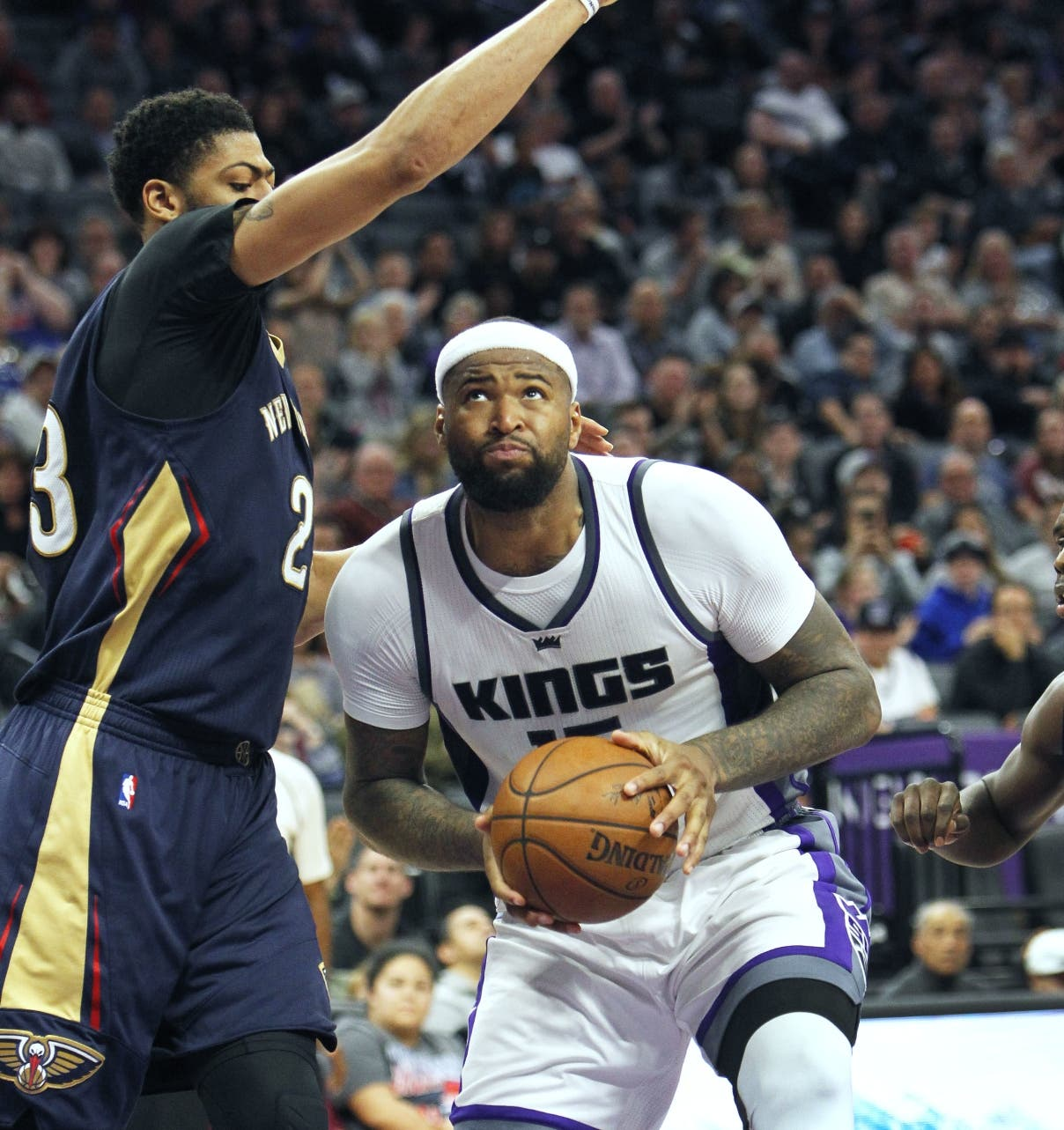 Sacramento Kings center DeMarcus Cousins (15) battles for position under the basket against New Orleans Pelicans defender Anthony Davis (23) during the second half of an NBA basketball game in Sacramento, Calif., Sunday, Feb. 12, 2017. The Kings won 105-99. (AP Photo/Steve Yeater)