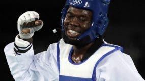 Luisito Pie of Santo Domingo celebrates after defeating Rui Braganca of Portugal in the Men's Taekwondo 58-kg quarterfinal at the 2016 Summer Olympics in Rio de Janeiro, Brazil, Wednesday, Aug. 17, 2016. (AP Photo/Andrew Medichini)