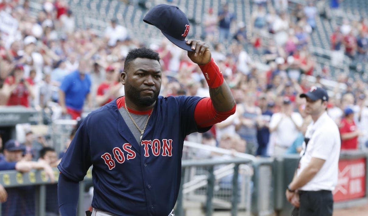 Boston Red Sox David Ortiz doffs his cap as he acknowledges fans as he is honored by the Minnesota Twins prior to a baseball game against the Minnesota Twins Friday, June 10, 2016, in Minneapolis. Ortiz was to be honored by the Twins before the game as he makes his farewell tour before retiring at the end of the season. (AP Photo/Jim Mone)